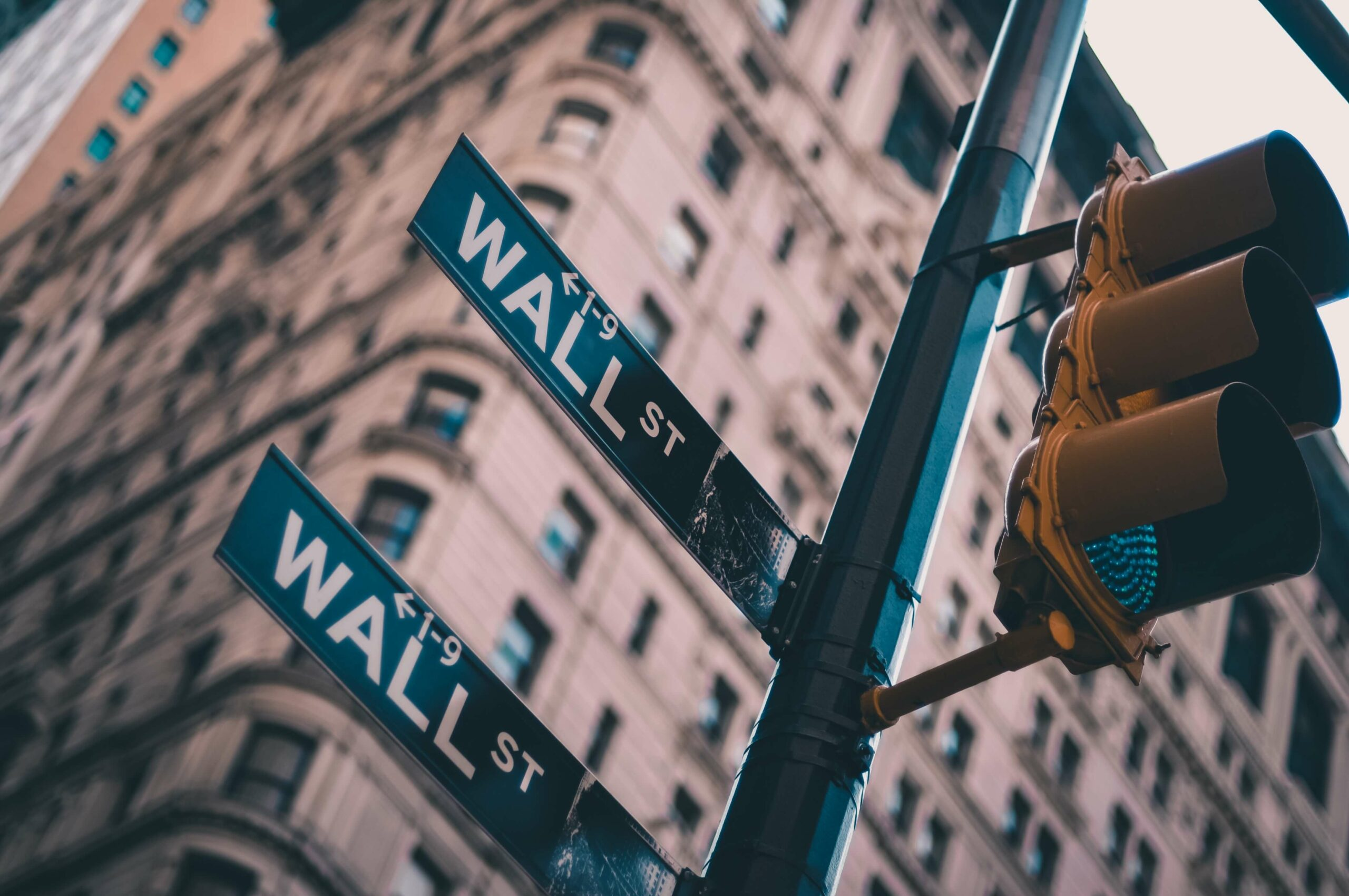 wall st street sign and traffic sign
